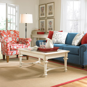 thomasville denim sofa and floral red chair